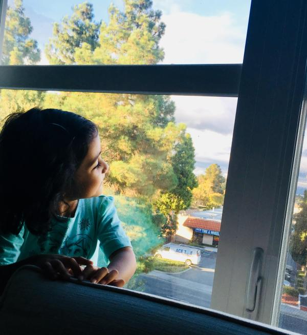 kid looking out of window