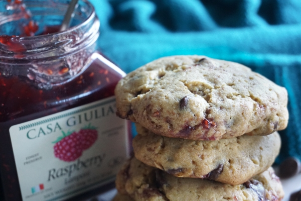cookies stacked with raspberry preserve on the side