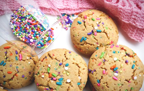 four funfetti cookies with funfetti in the glass