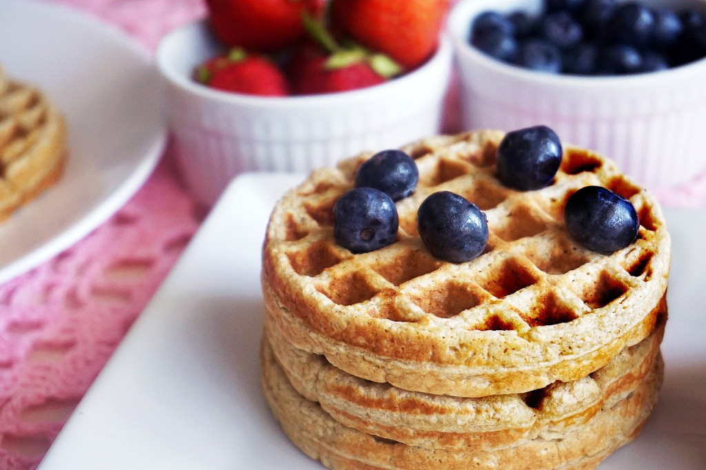 Stack of waffles with blueberries on top