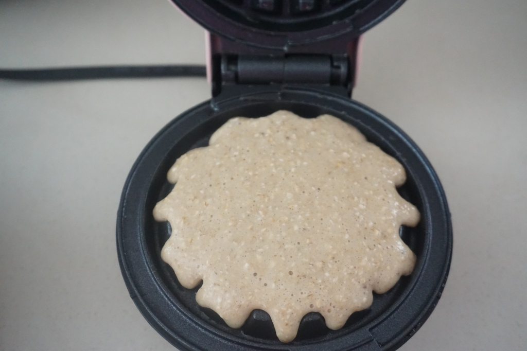 Batter poured in a waffle maker